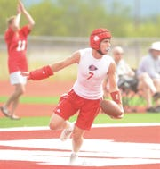 Jim Ned's Zach Henderson reacts after scoring a touchdown against Little River Academy during Jim Ned's 7-on-7 state-qualifying tournament Friday, June 14, 2019, at Indian Stadium.