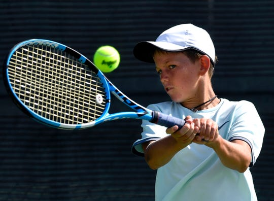 Lachlan Buckingham backhands during his match at Abilene Christian University in Friday's Texas Slam tennis tournament. He won fifth place in the Boys 12s with a 6-3, 6-3 win over Timothy Nguyen.