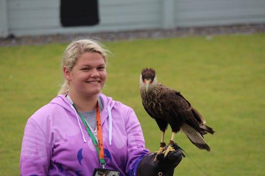 Feona MacBrock gets a close encounter at the Burren Birds of Prey Center.