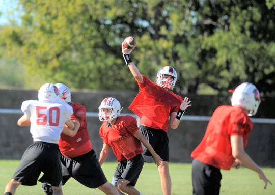 Baird quarterback Trace Price throws a pass during a practice Oct. 10, 2018, at The Bears Den.