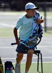 Lachlan Buckingham stands ready to play Friday morning for another set during Friday's Texas Slam tennis tournament.