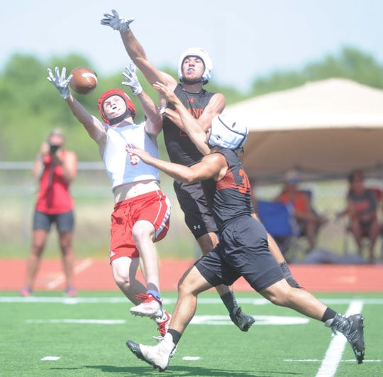 Jim Ned's Reese Hayes goes for a catch in the state-qualifying round against Llano during Jim Ned's 7-on-7 state-qualifying tournament Friday, June 14, 2019, at Indian Stadium.