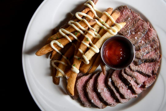 The steak frite at Shine in Hendersonville is roasted and grilled medium and served with duck fat fried potatoes.