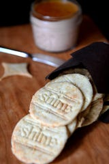 House-made crackers feature a baked-in logo and accompany the duck liver pate at Shine in Hendersonville.