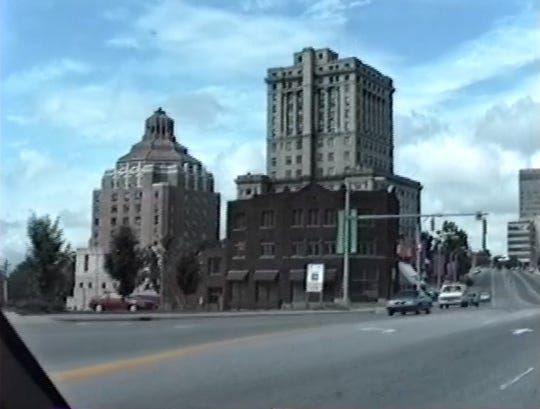 A view of Asheville City Hall and the Buncombe County Courthouse from College Street taken from a July 1989 video shot by Lynchburg, Virginia resident Kipp Taegue.