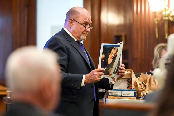 Jack Stewart, attorney for Nathaniel Dixon, holds a photograph of Candace Pickens June 14, 2019.