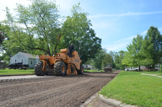 Crews pulverize 32nd Street North in preparation for a water main replacement project.