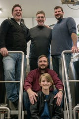 The members of Hot Dogs & Gin are, back from left, Mike Whittemore, Steve Shimer and Gordie Gottlieb, as well as Doug Hubert, middle, and his son, Eamonn Hubert.