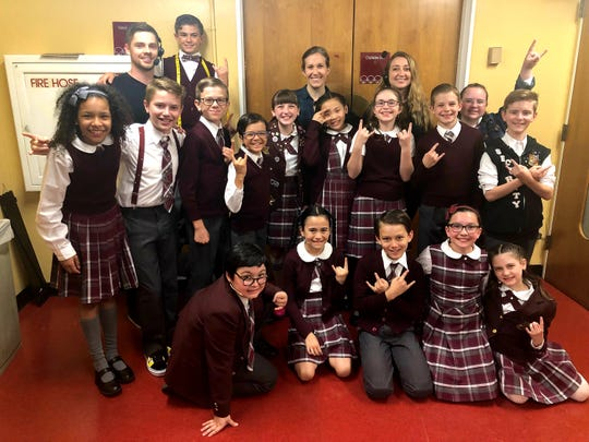 """Eamonn Hubert, middle row right,  among the cast and crew of the National Tour of """"School of Rock."""""""