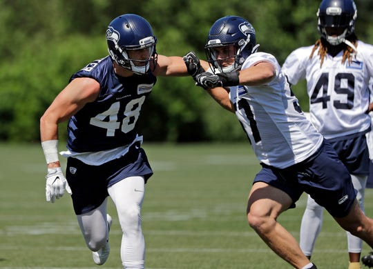 Seattle Seahawks' Jacob Hollister (48) pushes off of Cody Barton during a drill, Thursday, June 13, 2019, at the team's NFL football training facility in Renton.