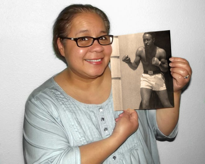 Mary Jara Norausky holds a photo of her biological father, Black Mountain native Wallace Burnette, who passed away in 2000 while still searching for the daughter who was conceived in 1963, when Burnette was stationed at the Subic Bay Naval Base in the Philippines.