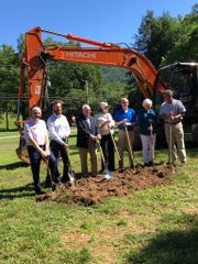 From left to right: Montreat officials commissioner Tom Widmer, town administrator Alex Carmichael, mayor Tim Helms, commissioners Alice Lentz, Bill Gilliland, Kitty Fouche and Kent Otto break ground on a new town hall on June 11.