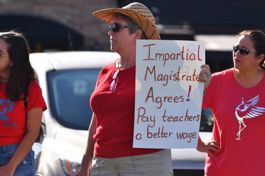 A few hundred people showed up Friday morning at The Avenue Viera to show support for teachers. The group marched north along Lake Andrew Drive and west on Judge Fran Jameson Way to the school board offices chanting slogans in support of teachers.