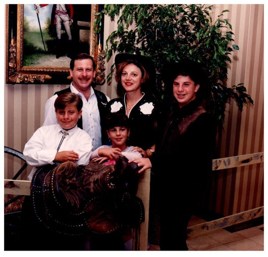 Alan and Pat Jotkoff are pictured with their children, sons Ryan and Eric and daughter Alex, at Ryan's bar mitzvah in June 1994.