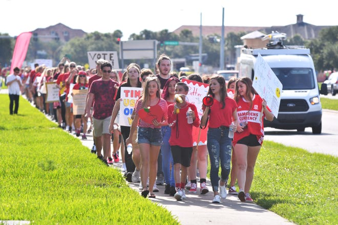 Students march in support of teachers recently in Viera. Another such march is planned before an impasse meeting at 9 a.m. in Viera on Monday morning.