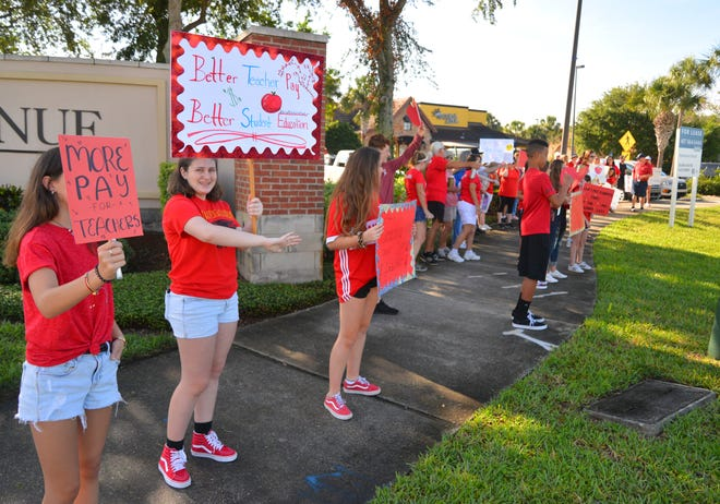 A few hundred people marched from The Avenue Viera to the Brevard school board offices June 14, chanting slogans in support of teachers.