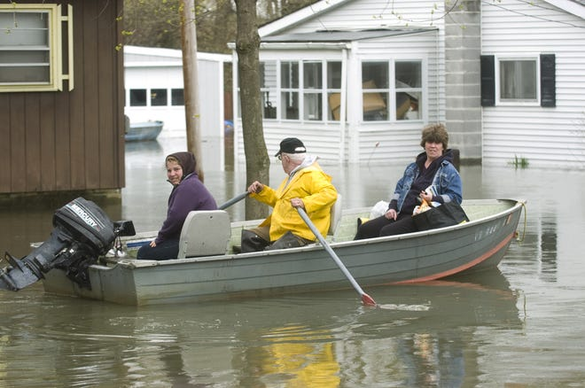 Residents of North Cove Road in Burlington, Vermont's New North End get to their homes by boat on May 11 as Lake Champlain floodwaters continued to rise.