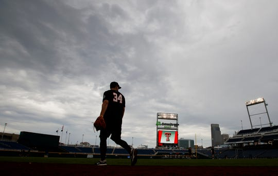 Texas Tech's Micah Dallas and teammates practice for baseball's College World Series at TD Ameritrade Park, Friday, June 14, 2019, in Omaha, Neb. (Ryan Soderlin/Omaha World-Herald via AP)