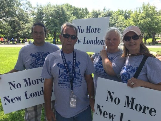 From left: Kimmy Garcia, Mark Bean, Lynda Garcia and Jennifer Bean. They traveled from Longview to the Texas Capitol for the plumbers rally, June 14, 2019.