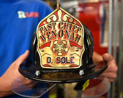 Ryan Sole holds his father's helmet at the Wenonah Fire Company on Thursday, June 13, 2019.