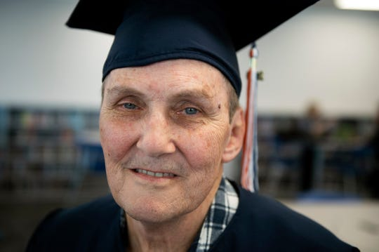 Vietnam veteran George Schaefer, 67, poses in his cap and gown Friday, June 14, 2019 at Overbrook High School in Pine Hill, N.J. Schaefer will receive his diploma 50 years after leaving school to enlist in the military.