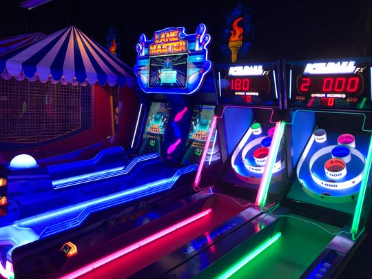 Even the arcade glows at Monster Mini Golf in Cherry Hill, part of a franchise that bills itself as 'the leader in blacklight family entertainment.'