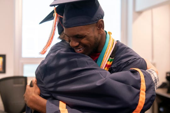 Class president Maurice Wade hugs Vietnam veteran George Schaefer, 67, Friday, June 14, 2019 at Overbrook High School in Pine Hill, N.J. Schaefer will receive his diploma 50 years after leaving school to enlist in the military.