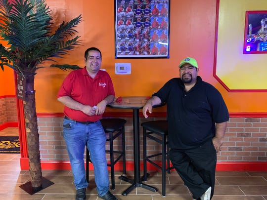Los Jalapenos owners Jose (left) and Ever Merino stand near the bar at their new location of Los Jalapenos Bar & Grill (formerly Jalapenos Grill 2).
