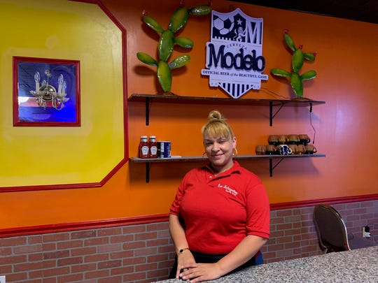 Waitress Yari DeJesus of Lindenwold works behind a counter of the new Los Jalapenos Bar & Grill in Haddon Township.