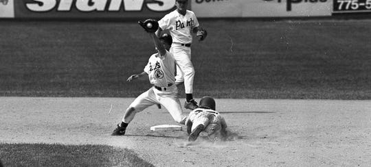 Chillicothe's Todd Smith tries to tag Doug Meiner of Portsmouth during the Paints' doubleheader. The Paints dropped two games to the Portsmouth Explorers 4-1 and 3-2 in July 1994.