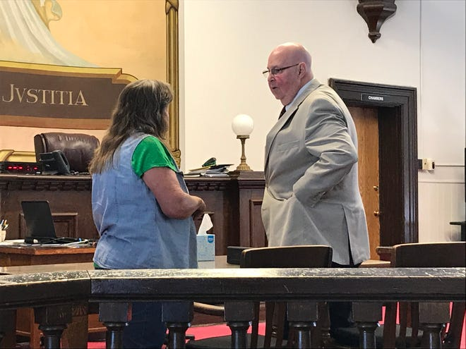 Rita Newcomb talks with her attorney Frank Gerlach after a pretrial hearing on June 14, 2019, in the Pike County Courthouse.