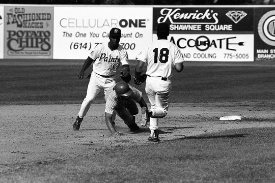 Sherron Rives, left, and Aaron Foley of the Chillicothe Paints catch Steve DanRemsum as he tries to steal third. The Chillicothe Paints played a doubleheader against Portsmouth on July 3, 1994. They won 4-2 and 3-2.
