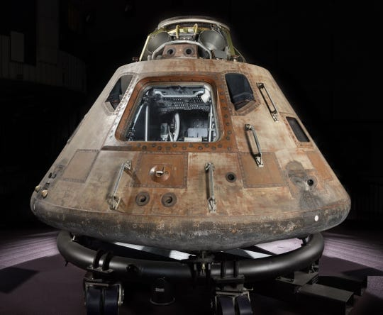 The Apollo 11 command module Columbia sits on a temporary cradle.