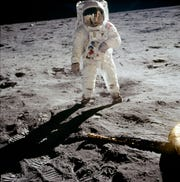 Astronaut Buzz Aldrin walks on the surface of the moon near the leg of the lunar module Eagle during the Apollo 11 extravehicular activity (EVA).