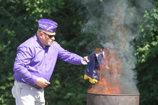 John Brown with the Military Order of The Purple Heart had the honor of retiring hundreds of flags at the Flag Day Ceremony on Friday, June 14, 2019.