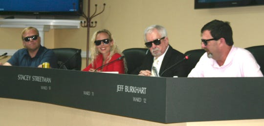 "Clarksville City Council members Jeff Henley, Stacey Streetman, Gary Norris and Jeff Burkhart wear ""Men in Black"" sunglasses for the vote on the CDE Lightband budget, which was ""in the black"" for the first time, on Thursday, June 13, 2019."