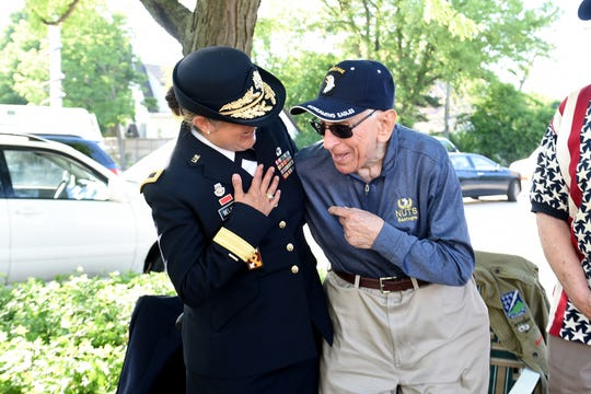 Brig. Gen. Kris Belanger, left, with Al Mampre, who was a medic with the Band of Brothers in World War II.