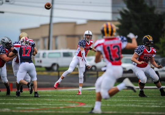 Quarterback David Lepoidevin of Bound Brook fires up field for Jack Willard (13) of Delaware Valley  in the Basilone Bowl in Bridgewater on June 13, 2019.