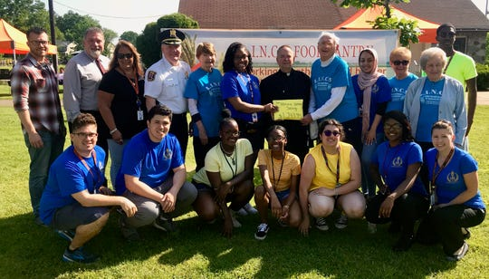 The Linden High School National Honor Society presents a donation of more than $1,700 to representatives of the LINCS Food Pantry at the annual walkathon at Wilson Park.
