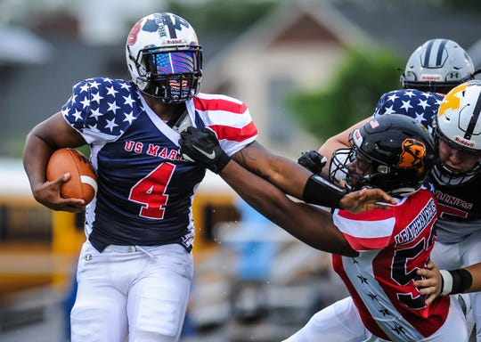 Anthony Goffe of Bridgewater-Raritan stiff arms Quron Smith of Somerville on his way down the field in the  Basilone Bowl in Bridgewater on June 13, 2019.