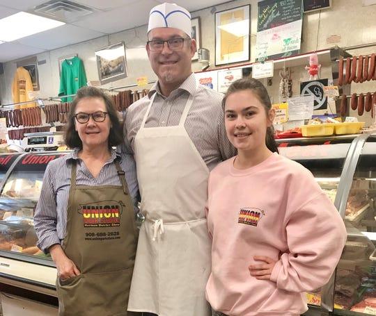 Bozena Jablonski, Leszek 'Jabi' Jablonski and their daughter at the Union Pork Store.