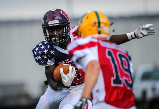 Shekuna Kamara of Franklin makes a move to get past J.J. Miller of Montgomery in the  Basilone Bowl in Bridgewater on June 13, 2019.
