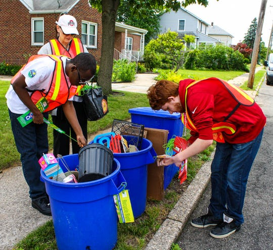 Participants in the PAL program help ensure Sayreville residents are recycling properly.