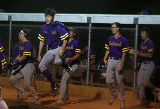 Indianola players flood out of the dugout to celebrate the winning run. Indianola broke a 2-2 tie in the 11th inning to beat Centerville 3-2 in a June 13 home game.