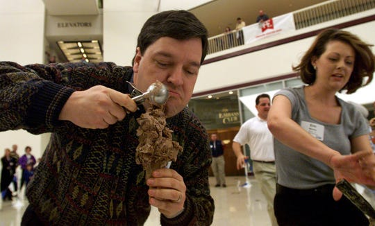 Van Harden of WHO Radio piles on the Drake's Chocolate Pentathlon ice cream in a celebrity pentathlon Friday at Capitol Square. The relay team had 3 minutes to add to their cones, one scoop each time for the 2-person teams. Erin Moody of KCCI-TV is at right. Anderson-Erickson kicked off the new flavor in honor of the Drake Relays in this 1999 photo.