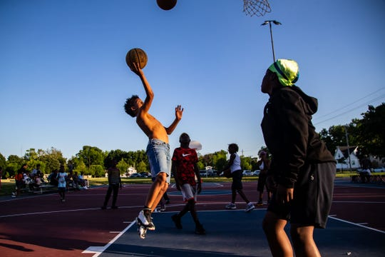 Juelz Daye, 13, puts up a shot as residents pack Evelyn K. Davis Park for the kick off of summer city hoops Thursday, June 13, 2019.