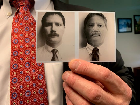 Former Special Agent in Charge for the FBI's Omaha Division Randy Thysse, 56, on May 22, 2019 holds a picture of himself from February 1990, when he began his FBI career in Des Moines. Thysse's last day with the FBI was May 31. He is now working in his native Minnesota.