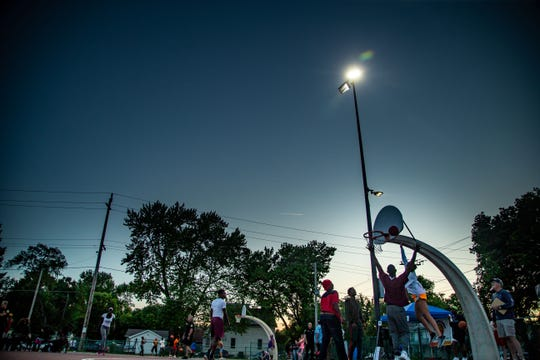 Residents pack Evelyn K. Davis Park for the kick off of summer city hoops Thursday, June 13, 2019.