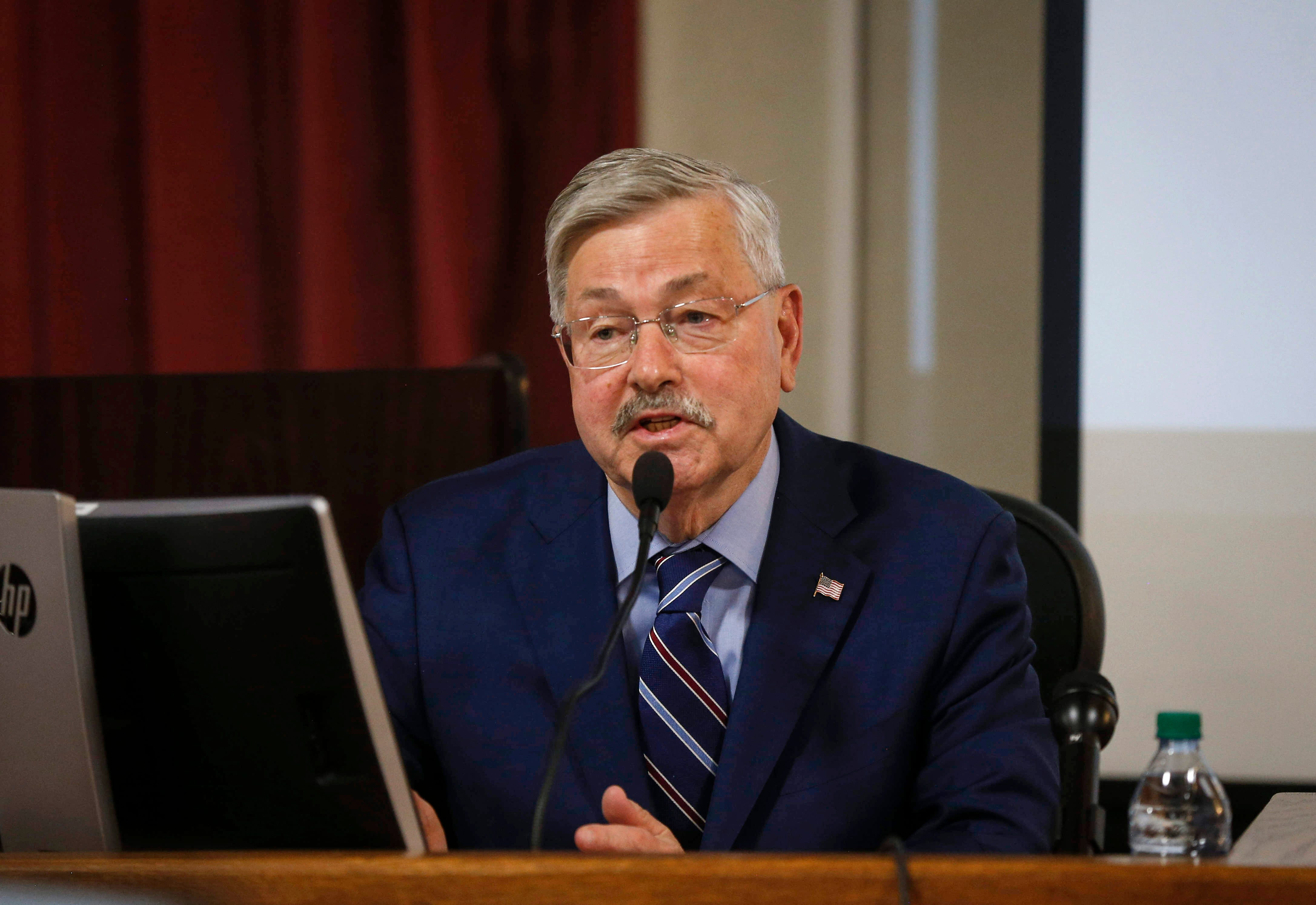 Terry Branstad claims no discrimination in cutting gay official's pay
