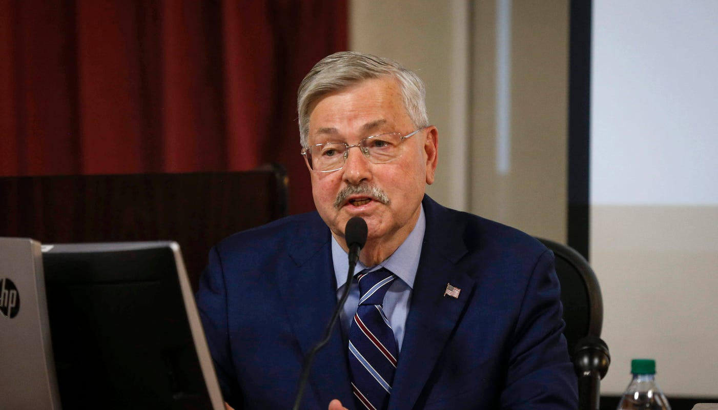 Terry Branstad, in Iowa court, says he didn't discriminate when he cut gay official's pay